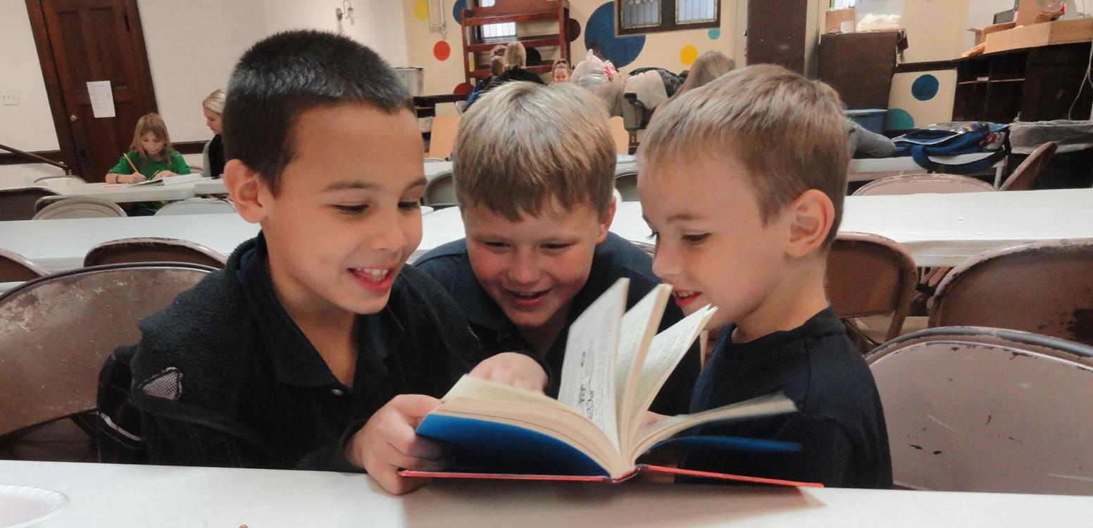 afterschool-kids-reading-smiling