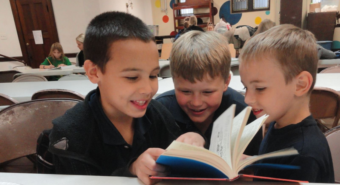 cropped-afterschool-kids-reading-smiling-1.png